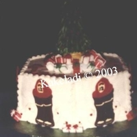 Fire Dept Christmas This hexagon cake is iced in b'cream. Boots/helmet are colorflow. On top of the cake is a 3-d tree made from an ice cream cone. Sugar...