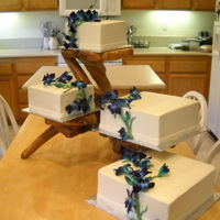 Blue Orchids buttercrea, cake.... real orchids with fondant vine
