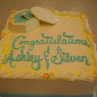 Engagement Cake   buttercream cake with lemon moussebox is made of white chocollate... ring is fondant