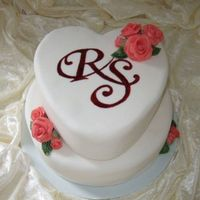 Monogram And Roses A cake with mongram and roses, they wanted elegant and simpel.