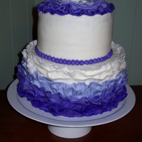 Purple Ruffled Cake Two-tier buttercream cake with fondant ruffles