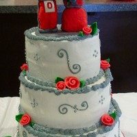 Brutus And Mrs Brutus Buckeye Wedding Made this cake for a wedding vow renewal ceremony. Couple are huge Buckeye fans. Couple wanted Brutus and Mrs Buckeye on top of their cake...