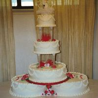 "Red And White Wedding Tiers There are two 12"" rounds on the bottom topped with a 10"", 8"" and 6""; all iced and decorated with buttercream. Royal..."