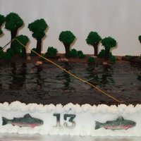 Carter's Fly Fishing 12 x 18 cake w/BC icing. I carved a bit of a dent across the middle for the depth of the water. Gum-paste figure (CelShapes - fairies mold...