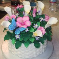 "Basket Of Flowers 8"" double layer butter cake w/BC icing. Gum-paste flowers and butterfly painted w/ petal/luster dust. Experimenting with a topper that..."