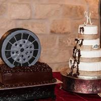 Muddy Tire Splatered Wedding Cake Four tier country, chic wedding cake with grooms and tire splatering wedding cake.