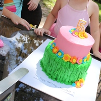 Luau Cake   For my munchkin Meredith last year... Buttercream with fondant accents.