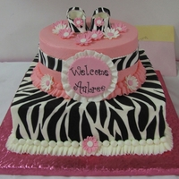 Welcome Aubree! BC with fondant zebra stripes and flowers and GP baby shoes.