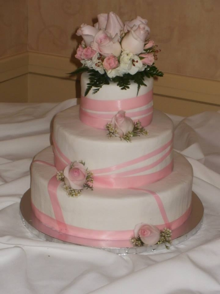 Buttercream Icing With Satin Ribbons And Fresh Flowers Buttercream icing with satin ribbons and fresh flowers