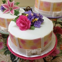 Mothers Day Banquet   Painted cake with Gumpaste Flowers. This cake was inspired by Wilton.