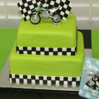 Motor Cross Themed Baby Shower   This cake made to match the colors of a motor bike the father to be owns.