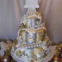 Elegant Christmas Tree French vanilla cake with french vanilla butter cream covered in fondant. All items are edible except the wooden dowels and the threading...