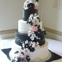 Black And White Wedding This was inspired by a picture the bride found online. Buttercream frosting with fondant ribbon. Gumpaste flowers.