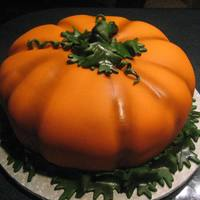 "Big Pumpkin! Big Pumpkin fun for the Halloween or Thanksgiving holiday! This cake was made using 3 - 12"" round cakes - rounding the top and bottom..."