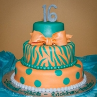 Sweet Sixteen!! Sweet Sixteen Birthday cake for 4 girlsCoral & Teal Fondantsparkly 16 on top - custom bow - zebra design - dots