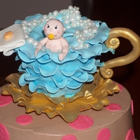 Baby Shower Baby in a Tea Cup having a bath.Chocolate cake, filled with chocolate gananche, frosted in chocolate buttercream. All other decorations are...