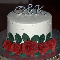 Red Roses Wedding Cake Chocolate cake filled and frosted in buttercream. The roses and leaves are Mexican Paste, dusted with a little gold luster dust. Edible...