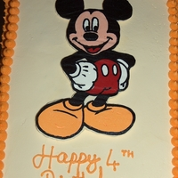 Mickey Mouse Rainbow cake frosted in buttecream, Mickey Mouse is a FBCT