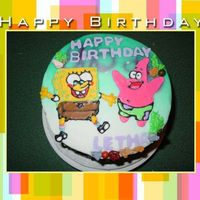 Spongebob And Patrick round cake with buttercream frosting, airbrushed background, colorflow characters, fondant letters, and candy rock accents