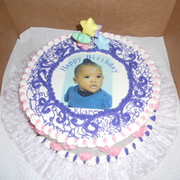 Granddaughters 1St Birthday Vanilla cake iced with buttercream icing.