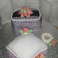 Bridal Shower A gift box and pillow cake with a pearl bracelet. Cake is vanilla with guava and whipped cream frosting covered in fondant. Gumpast calla...
