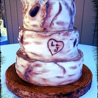 Birch Wedding Birch wood wedding cake. Cake board made of fondant covered cardboard with bark on the side.