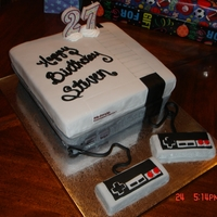 Nintendo White cake with buttercream...fondant accents ( fondant covered brownie paddles )