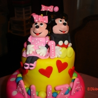 "Mickey And Minnie 12""-10""-6"" sour cream white and whipped white chocolate ganache top and lower tier and middle triple threat chocolate and..."