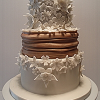Wedding Cake   Done with ivory and coffee fondant to match the wedding dress