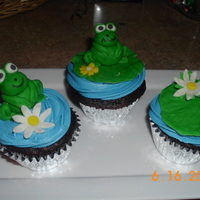 Frog Cupcakes Chocolate Cupcakes, Buttercream icing, and fondant frogs, lily pads and flowers.