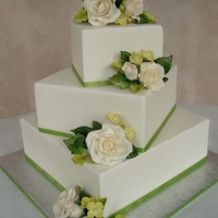 Rose Cascade off set wedding cake with sugar roses and foliage