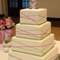 Criss Cross Ribbon Wedding Cake Fondant cake with satin ribbons