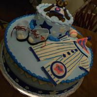 All Star Baby Marble cake iced in butter cream, with fondant decorations.