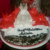 Wedding Party Bridal shower cake with a bride dress as the center of 4 bridesmaids dresses