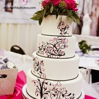 Floral fondant cake with hand-pianted design