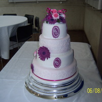 Round Wedding Cake Four tier, gerbera and roses and brush embroidery