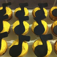 Muscial Cupcakes Cupcakes with fondant musical note on top.