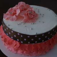 Pink Buttercream icing with fondant accents. The flowers are gumpaste. Inspired by various cakes on CC.