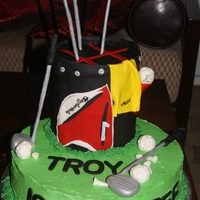"Golf - Forty 12"" Cinnamon Swirl Cake. The top tier is 2 - 6"" cakes. Golf clubs and balls are gumpaste."