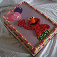 Elmo 1St Birthday A girly version of the Elmo cake I have done before, originally inspired by a KimAZ cake. 12x18 sheet and shaped Elmo smash cake from a 6&...
