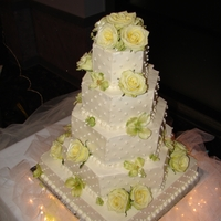 Hexagon Mixed Shape Wedding Cake All buttercream with edible pearls and combination of fresh and silk flowers