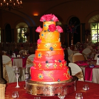 Indian Inspired All buttercream with fondant accents. Shades of fuschia,orange and navy. Fresh flowers