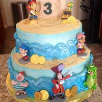 "Jake And The Neverland Pirates all buttercream waves with graham cracker ""sand"". The map was hand cut from gumpaste!"