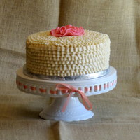 White Ruffles W/pink Gumpaste Flower scratch red velvet cake with cream cheese frosting. Simple gumpaste flower decoration