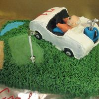 Golf Cart On Green Back of golf cart with fondant golf bag and clubs. TFL.