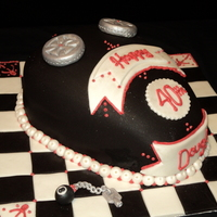 Harley Davidson Gas Tank Chocolate and orange layer cake covered in fondant, piped with red buttercream. This cake was so much fun to make plus great reactions once...