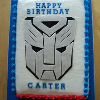 Transformer Birthday Cake   9x13 cake frosted and filled with BC. I made the mask out of fondant.TFL!