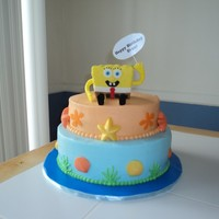"Spongebob Cake  10"" chocolate cake, 8"" vanilla cake. All iced in buttercream, chocolate seashells and starfish. I made spongebob out of RKT and..."