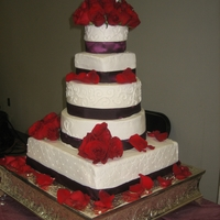 Plum & Red Wedding I must admit, this picture was taken BEFORE the top tier with roses and hearts fell down. Thankfully it was my cousin's wedding who...