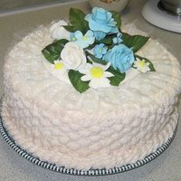 Birthdaycake_001.jpg Chocolate cake with almond flavored buttercream icing. Flowers are all made with gum paste. Basketweave on sides and borders are rope...